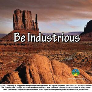 image of huge red rock coming out of flat plains with the words Be Industrious in the middle of the picture